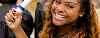 African descent college student at college graduation.